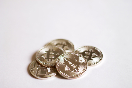 Bitcoins on a white background. A concept from coins of the cryptocurrency.