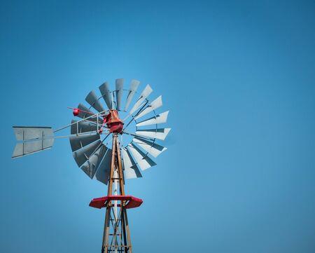 Antique texan farm windmill with clear sky on a sunny day Stock Photo
