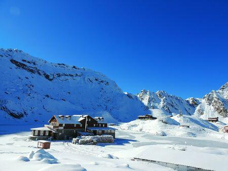 Isolated mountain cabin. Winter in Fagaras Mountains,Romania.