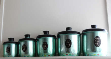 Set of green anodized antique kitchen canisters