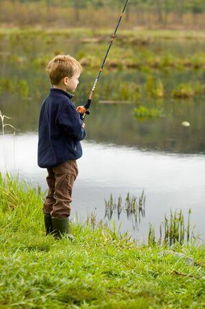 children pond: Child fishing