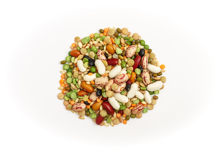 Mixed dried legumes and cereals isolated on white background. Top view
