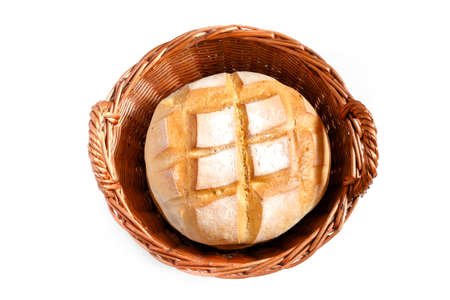 weaved: Round loaf of bread in weaved basket isolated on white background