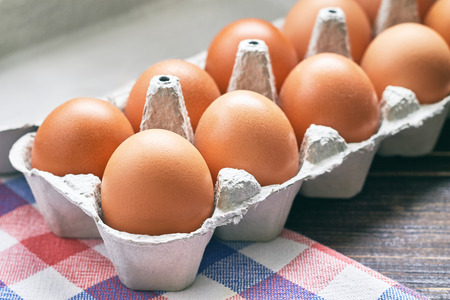 pulp: Chicken eggs in pulp egg carton on table