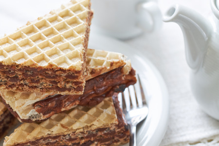 cookies and cream: Stack of wafer sheets filled with caramelized sugar and hazelnut cream served on white plate Stock Photo