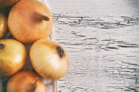 Onions on white rustic wooden background. Top view with copy space Stock Photo