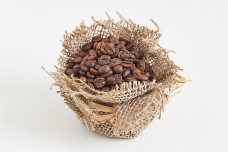 Roasted coffee beans in small burlap bag isolated on white background Stock Photo