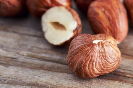 blanch: Peeled hazelnuts on wooden background, close-up with copy space Stock Photo