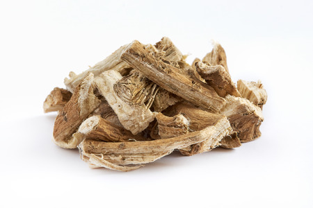 Pile of dried and sliced marshmallow root (Althaea officinalis) isolated on white background Stockfoto