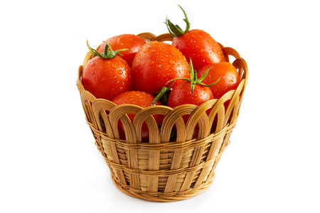 white washed: Fresh cherry tomatoes in woven basket isolated on white background