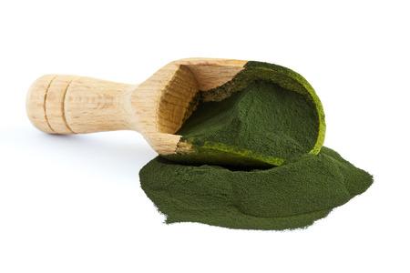 Chlorella algae powder with wooden scoop isolated on white background