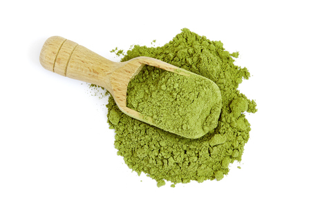 Moringa oleifera powder with wooden scoop isolated on white background. Top view Stockfoto