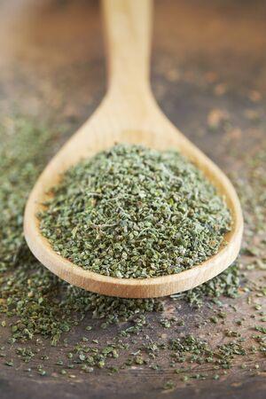 Stinging nettle (Urtica dioica) seeds in wooden spoon Reklamní fotografie