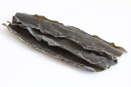 Dried kombu seaweed (Laminariaceae longissima) isolated on white background