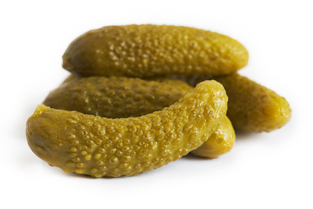 Pickled cucumbers, also known as gherkins or cornichons, isolated on white background Banco de Imagens