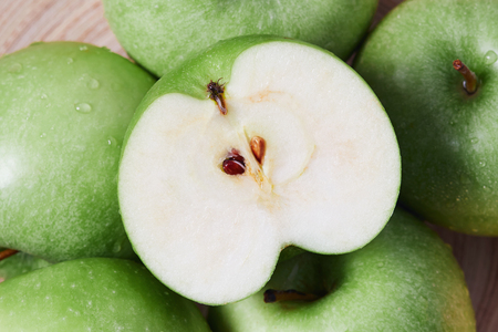 Closeup of halved fresh Granny smith green apple