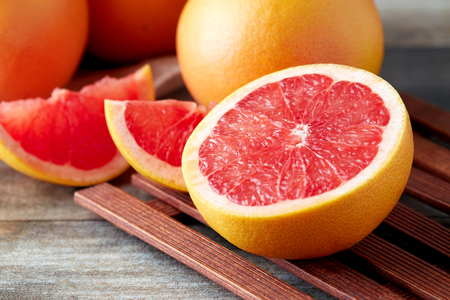 Fresh raw grapefruit (citrus x paradisi) on wooden background