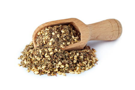Za'atar (zatar), Middle Eastern spice mixture isolated on white background 免版税图像