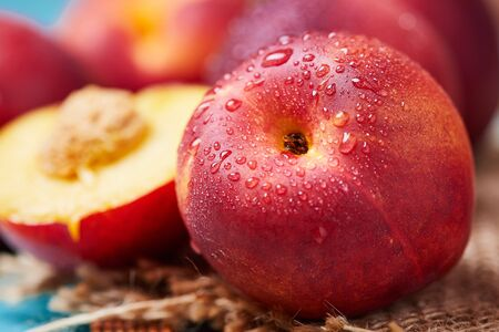 Close up of fresh ripe nectarines with water drops