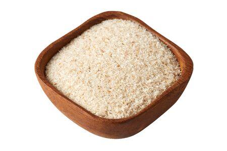 Psyllium (ispaghula) husk in wooden bowl isolated on white background