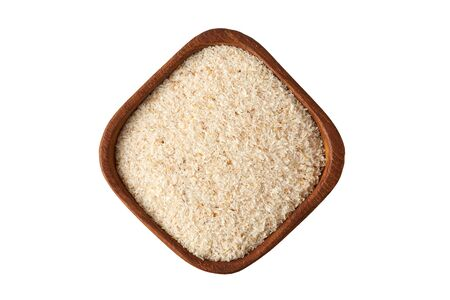 Psyllium (ispaghula) husk in wooden bowl isolated on white background. Top view
