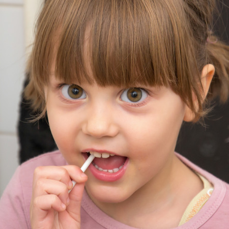 southern european descent: Adorable Girl With Pigtails And Big Eyes Stock Photo