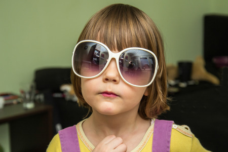 Little girl with oversized sunglasses