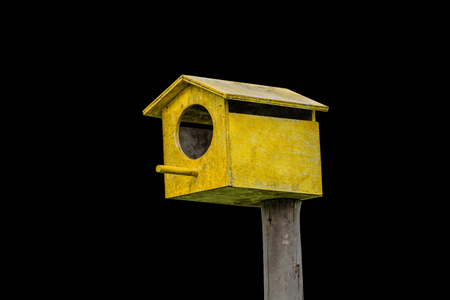 single dwelling: Wooden bird house is made of wood house for bird nesting habitat Wang eggs. Stock Photo