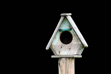 starling: Wooden bird house is made of wood house for bird nesting habitat Wang eggs. Stock Photo