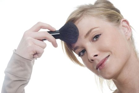 Portrait of a young woman doing makeup
