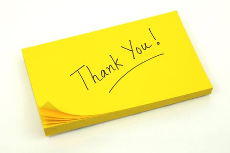 note of thanks on a yellow pad