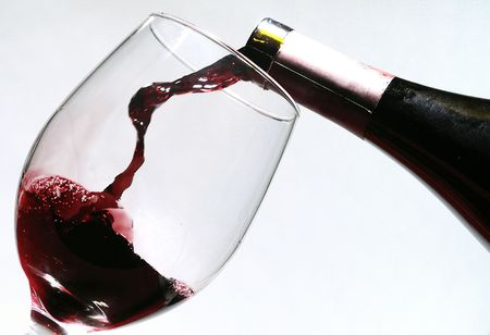 red wine pouring: pouring red wine into a glass