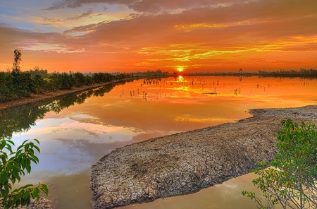 Brilliant sunrise across a river in Sundarban islands in India