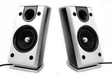 Pair of silver pc speakers isolated over white background photo