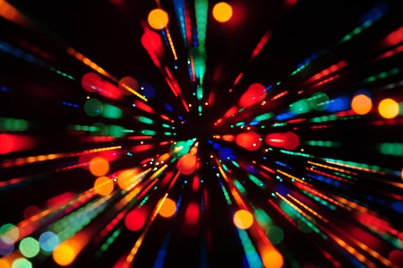 Multi colored abstract background of out of focus party lights streaks