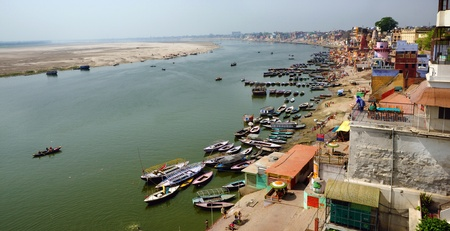 reincarnation: A panoramic birds eye view of the ancient city of Varanasi with the holy Ganges river flowing by it. Stock Photo
