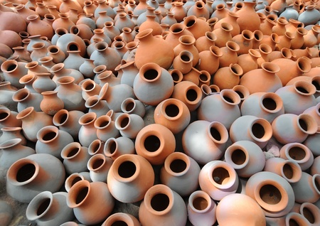 clay craft: Hundreds of earthen water jars used in rural areas are stacked together