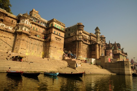 Ancient Varanasi city with its fortresses and temples along the bank of river Ganges photo