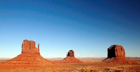 tribal park: East and West Mitten and Merrick Butte at Monument Valley Navajo tribal park on a clear day