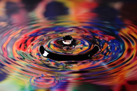 Colorful droplet of water on a reflected on artists pallete Imagens