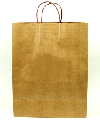 Brown paper shopping bag isolated over white background photo