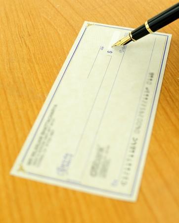 nib: Writing a check using a fountain pen, focus on the nib