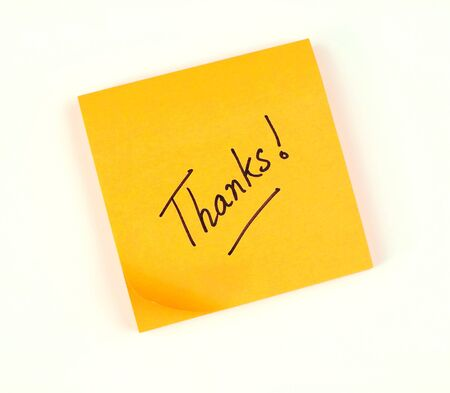 A note of thanks scribbled on a bright color post-it pad photo