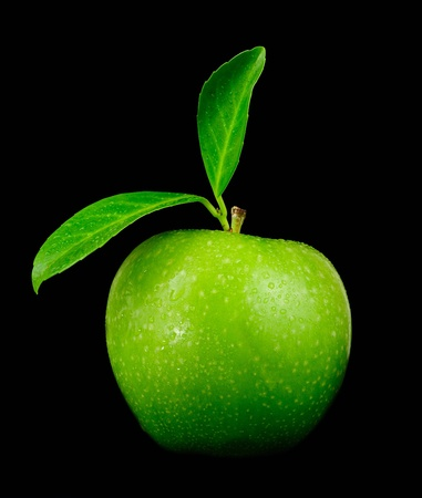 Fresh green Granny Smith apple with leaves isolated over black Stock Photo