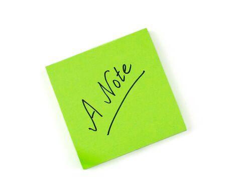 sticky note: A note scribbled on a green sticky pad