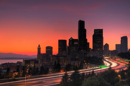 seattle skyline: Seattle downtown glowing red in hot summer, freeway traffic in foreground