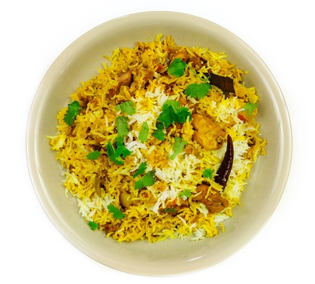 Delicious Chicken Biriyani - an exotic traditional Indian cuisine served with cilantro and herbs photo