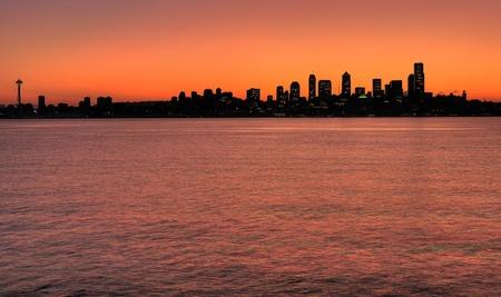 seattle skyline: Silhouette of Seattle skyline before sunrise from Alki point