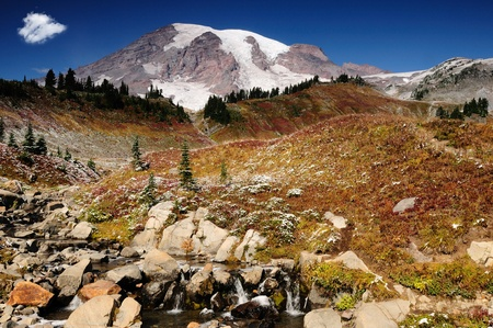 blushing: Majestic Mount Rainier blushing with valleys covered with fall colors Stock Photo