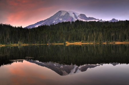 Striking image of Mount Rainier perfectly reflected across the reflection lakes at dusk photo